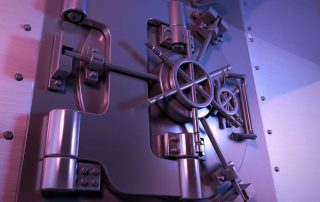 Image of a steel vault door to illustrate security.